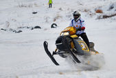 Sport snowmobile race on track — Stock Photo