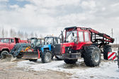 Tractors and truck stand on open area — Stock Photo