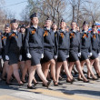 Female cadets of police academy marching on parade — Stock Photo #58567539