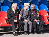 Senior veterans of World War II on tribune — Stock Photo