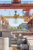Operator of crane works at finished good warehouse — Stock Photo