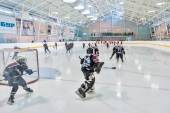Warm-up before game of children ice-hockey teams — Stock Photo