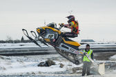 Snowmobile rider on sport track — 图库照片