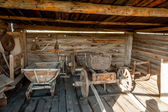 Wooden cart and other stock in museum — Stock Photo