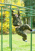 Teenage girl on climbing frame in relay — Stock Photo