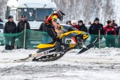 Race of sportsman on snowmobile — Stock Photo