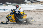 Snowmobile rider on sport track — Stock Photo