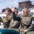 Attractive girls in uniform of times WW2 on parade — Stock Photo #63548393