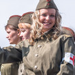 Truck with girls in uniform of times WW2 on parade — Stock Photo #63581393
