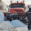 Постер, плакат: Worker controls snow cleaning process