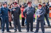 Four policemen stand in cordon — Stock Photo