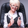 Beautiful smiling business woman shows thumb up — Stock Photo #64520207