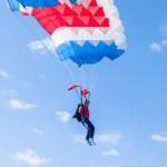 Paratrooper girl descends — Stock Photo #64633847