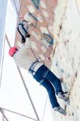 Man climbs upward on ice climbing competition — Stock Photo