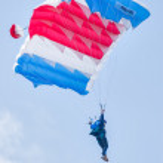 Paratrooper woman descends — Stock Photo #64808697