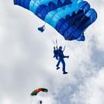 Paratrooper man descends — Stock Photo #64809633