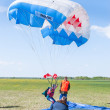 Parachutist woman missed by landing point — Stock Photo #64812021