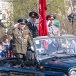 Veterans of World War 2 salute from SUV on parade — Stock Photo #64864331