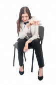 Pretty businesswoman with roubles sits on chair — Stock Photo