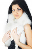 Attractive girl covered in white fur — Stock Photo