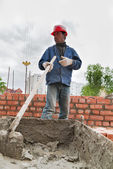 Builder man works with shovel at construction site — Stock Photo