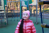 Portrait of beautiful girl on the playground — Stock Photo