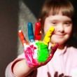 Cute little girl with painted hands — Stock Photo #66104919