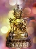 Statue of the Avalokiteshvara on bokeh background. — Fotografia Stock