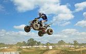 Quad bike jump — Stock Photo