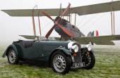 Vintage aircraft and motorcar — Stock Photo