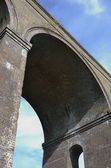 Looking up at viaduct arch — Stock Photo