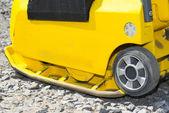 Yellow vibratory plate — Stock Photo