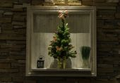 Small Christmas tree decorated in the frame — Stock Photo