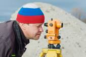 Engineer at the construction site makes measurements with leveli — Stock Photo