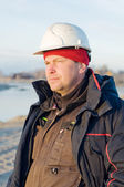 The foreman in the helmet is on the construction site — Fotografia Stock