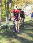 Cyclists competing in cyclocross race — Stok fotoğraf