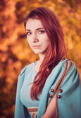 Redhead woman in vintage dress — Stock Photo