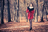 Sexy brunet walking at fall forest — Stock Photo