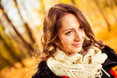 Smiling brunet portrait at fall forest — Stock Photo