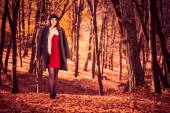 Woman in red dress and coat — Stock fotografie