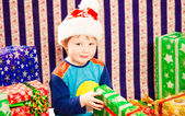 Smiling boy with Christmas gift — Stockfoto