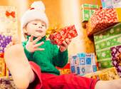 Funny boy with Christmas gift — Stock Photo