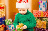 Boy holding holiday present — Stock Photo
