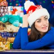 Young brunet portrait at holiday background — Stock Photo #58693845