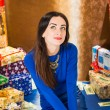 Woman in blue dress at Christmas presents — Stock Photo #58694255