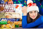 Young brunet with holiday presents — Stock Photo