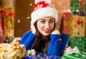 Happy brunet lady portrait with holiday presents — Stock Photo