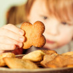 Boy taking cookie — Stock Photo #65545541