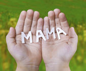 The word mother on children's hands — Stock Photo