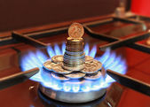 Gas burner with a blue flame and RUB — Stock Photo
